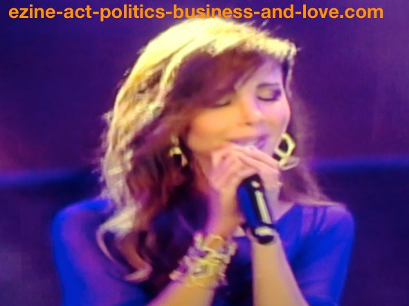 Ezine Acts Music: Arabian singer Nancy Ajram melting in her own music and song.