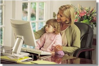 Online Business Consulting Services: Woman with her child enjoying computer-work.