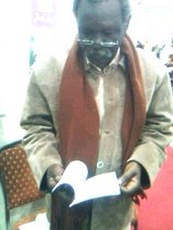 home-biz-trends.com/phoenix-order.html - Phoenix Order: Friend Attif Ismael reading Rising of the Phoenix by poet journalist Khalid Mohammed Osman in Cairo Book Fair 2010.