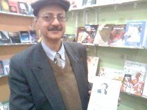 home-biz-trends.com/phoenix-order.html - Phoenix Order: Elhami Lutfi the owner of Alhadarah Printing in Cairo Book Fair with a copy of Rising of the Phoenix by Sudanese poet Khalid Mohammed Osman.